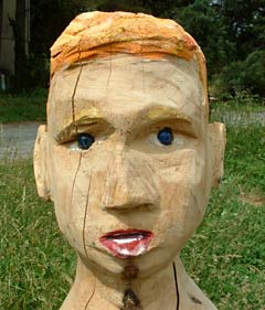 Sculpted and painted wood head by Sean